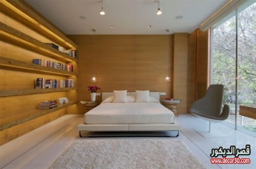 bedroom with wooden wall design